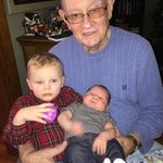 John holding two of his many grandchildren