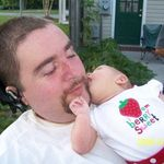 Isabel giving Uncle Monty kisses.