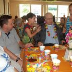 Papa enjoying a luau with grandchildren at Garden View!  Great food, fun, and most important family!