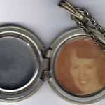 Cookie in Mom's locket. She's so young!