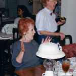 80th birthday. Yes, Cookie blew out the candles. NOTE: Her wine at the table - ha ha ha