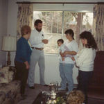 Cookie attending Natalie's baptism. From left: Cookie, son Marshall, Robin, Natalie, Ruth, and I believe that must be Murphy