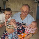 Harvey with three of his great-grandchildren, Alex, Elijah, and Elizabeth
