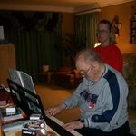 Grandpa playing piano. He taught many of his grandkids piano.