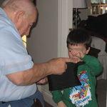 Dad teaching RJ a magic trick.