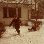 Nana pulling Joy and Jack in the sled