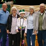 Jayden and his grandparents when he was crowned CES Cajun Carnival King