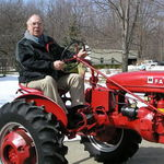 Dad and his Farmall Model BN.