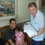 Holding M.J. with Alfred and Claudia, August 29, 2011