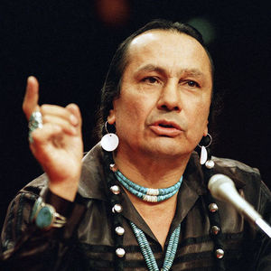 In a Jan. 31, 1989 file photo, Russell Means, who heads the American Indian Movement, (AIM) testifies before a special investigative committee of the Senate Select Committee on Capitol Hill, in Washington. Means, a former American Indian Movement activist who helped lead the 1973 uprising at Wounded Knee, reveled in stirring up attention and appeared in several Hollywood films, died early Monday, Oct. 22, 2012 at his ranch Zzxin Porcupine, S.D., Oglala Sioux Tribe spokeswoman Donna Solomon said. He was 72. (AP Photo/Marcy Nighswander, File)
