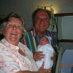 Grandpa and Grandma holding Camren at birth.