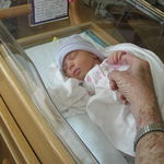 March 14, 2008  Audrey holding onto Pa's finger with her tiny hand,