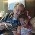 Pa and Audrey sharing a cookie at the Commons Stroke Rehabilation. March 2012