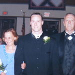 Robby and Ma and Dad coming down the isle