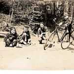 Glen -Lester Woodworth George (behind the front wheel of Jimmy Spragues Bike summer 1946