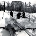 This is George in the cold of a Maine winter 1947-48 sorting lumber for a new sawmill