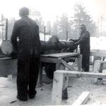 This is how desperate they were for lumber after that terrible fire of oct 1947 in Bar Harbor...Dad is Sawing and George is 'taking away' this is winter of 1947-48 so George would have been just 14 in that picture. Imagine working in the bitter cold just to get lumber to build your house!  Dad taught us both us boys how to work around saws and to respect machines ....none of us has lost a finger....yet !