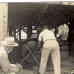 Uncle Allen Milliken WW1 vet ,Gill Peterson,back to camera  George is on other side of Saw . Mother took most of these pictures w/her trusty Box Brownie