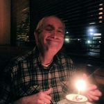 Dick on his 82nd birthday in October 2012 celebrating the day with a cheesy grin.