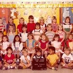 Mike is holding the sign. I am all the way to the left with the teacher's hand on my shoulder. Katie is behind Mike.