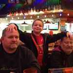 The boys at Hooters getting some chicken wings