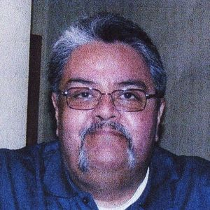 Mario L. De Alba