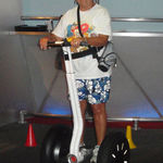 August 2010, Sandy's first ride on a Segway while in Disney World with her family.