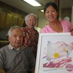 Kelly presents grandpa her design print for his 90th birthday.