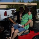 Tommy and his Dad Terry playing around on Grandpa Price's golf cart.