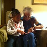 Camdyn reading to Grand-Nan