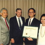 Rich receives his MAI certificate with Dad, Zoraster and Mom (1990)