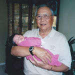 The proud grandfather with newly born granddaughter Lauren.