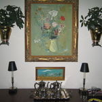 Mom watched Mr Strasser paint the floral painting as a demo.at Shawnee and bought it on the spot.