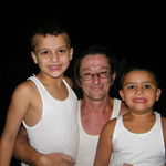 Doug and two of his grandsons in their matching tank tops.