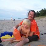 Doug and one of his grandsons, Ryder, play on the beach in Michigan.