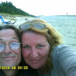 Doug and Kathy on the beach in Michigan .