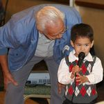 """A young Sebastian, stealing the spot light on the microphone.  """"I got this grandpa!"""""""