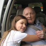 Emily Schommer with Grandpa on June 8, 2008.