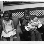 Sharon & Ronnie holding Connie 9-14-1952