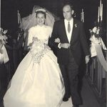 Larry and Carolyn Brink, walking down the aisle on November 2, 1957.