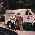 Burt Brink holding Tyler Brink, Steve Brink holding Brian Brink, and Larry Brink.