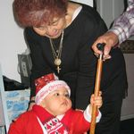 Playing with her great grandchild at Christmas 2004.