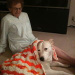 Mom and her 4-legged grand-daughter, Sammy.  She covered her up to keep him warm.
