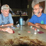 Walter and Dad at the kitchen table talking during poker game