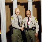 Awarded Medal of Valor in 2001 (pictured with Sheriff Baca)