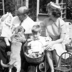 Ann Louise, Collier, John and Helen with the puppy Rebel, Easter in our backyard, 1964