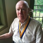 Mac in his kitchen with his 80th Birthday Medal and drinking coffee  Alexandra,VA.