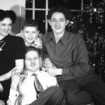 Family Christmas Portrait: Larry with his Mother, Arlene; Brother, Roy and Father, Don.