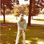 Larry golfing.
