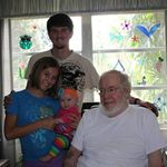 Dad with his Great Grandchildren, Logan, Setten and newest addition to the family Jocelyn born Jan 9th 2012.